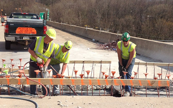 men working on roadway
